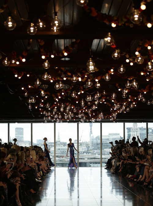 A model wears a creation by Matthew Williamson for his Spring/Summer 2013 collection at London Fashion Week in London, Sunday, Sept. 16, 2012. (AP Photo/Alastair Grant)