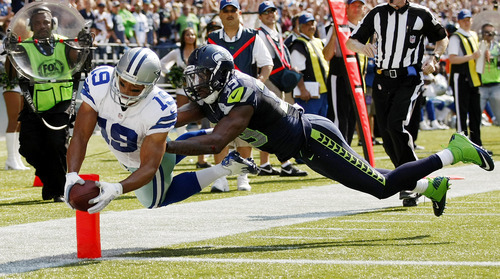 Dallas Cowboys wide receiver Miles Austin, left, dives across the goal line for a touchdown as Seattle Seahawks' Brandon Browner defends in the first half of an NFL football game, Sunday, Sept. 16, 2012, in Seattle. (AP Photo/John Froschauer)