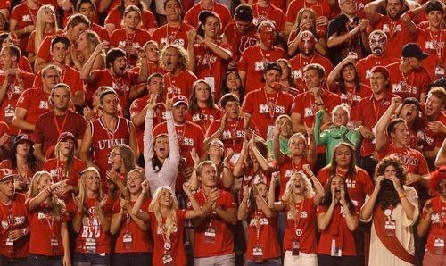Trent Nelson  |  The Salt Lake Tribune Utah fans cheer as Utah hosts BYU on Saturday, Sept. 15, 2012.