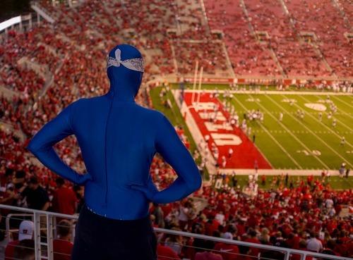 Trent Nelson  |  The Salt Lake Tribune A BYU super fan looks down on Rice-Eccles Stadium as Utah hosts BYU on Saturday, Sept. 15, 2012.