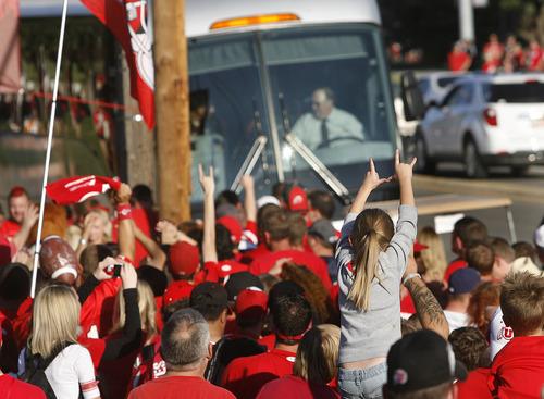 Scott Sommerdorf  |  The Salt Lake Tribune              Utah fans greet the team bus as it arrives at the