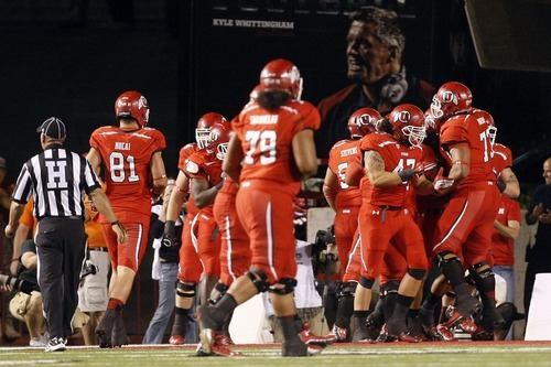 Chris Detrick  |  The Salt Lake Tribune Utah celebrates after their first touchdown during the first half of against BYU at Rice-Eccles Stadium Saturday September 15, 2012.