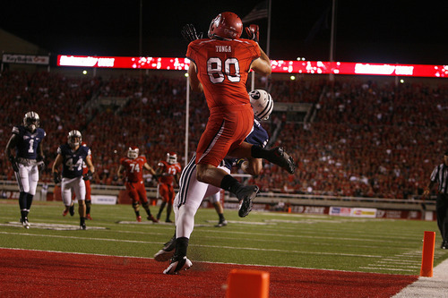 Scott Sommerdorf  |  The Salt Lake Tribune              Utah Utes tight end Westlee Tonga (80) goes up to catch the Utes TD pass, giving them an early 7-0 lead. Utah was tied with BYU 7-7 at the half, Saturday, September 15, 2012.