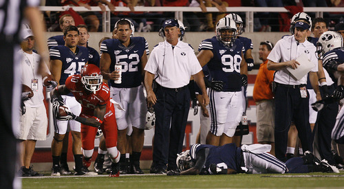 Scott Sommerdorf  |  The Salt Lake Tribune              The BYU sideline reacts as Utah Utes wide receiver DeVonte Christopher (10) gets loose along their sideline after a first half catch. Utah was tied with BYU 7-7 at the half, Saturday, September 15, 2012.