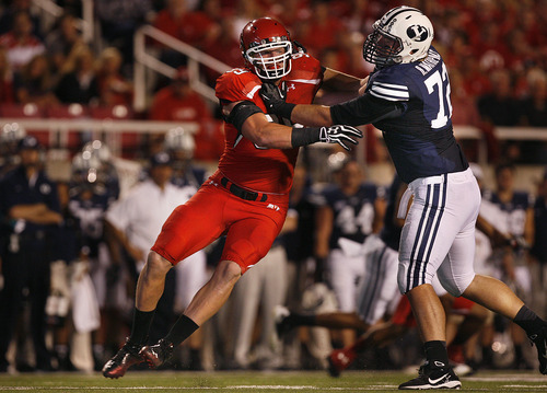 Scott Sommerdorf  |  The Salt Lake Tribune              Utah Utes defensive end Joe Kruger (99) is blocked by Brigham Young Cougars offensive linesman Ryker Mathews (72) during first half play. Utah was tied with BYU 7-7 at the half, Saturday, September 15, 2012.