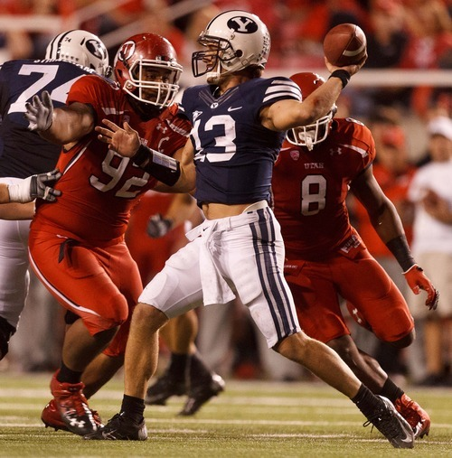 Trent Nelson  |  The Salt Lake Tribune Utah defensive tackle Star Lotulelei (92) closes in on Brigham Young quarterback Riley Nelson (13) during the game in Salt Lake City on Saturday, Sept. 15, 2012.
