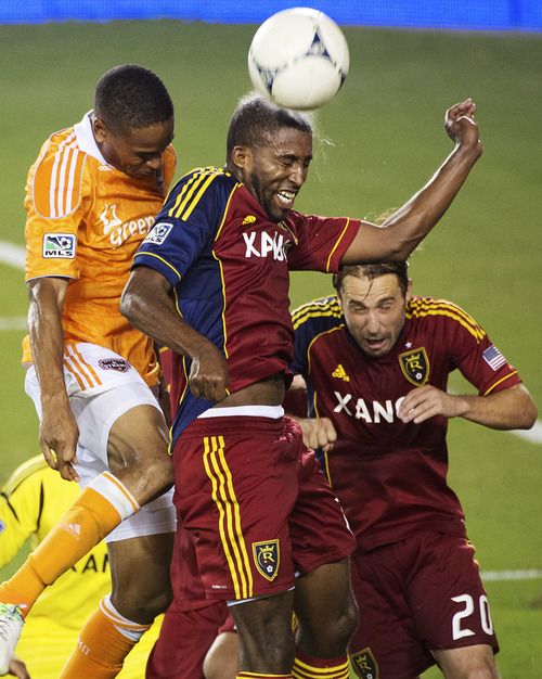 Real Salt Lake midfielder Yordany Alvarez wins a header against Houston Dynamo defender Ricardo Clark during an MLS soccer match, Thursday, Sept. 6, 2012, in Houston. Houston won 1-0. (AP Photo/Houston Chronicle, Smiley N. Pool)