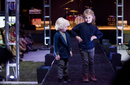 Kim Raff | The Salt Lake Tribune Child models for the Aven line stand at the end of the runway during Fashion Night Out at the Gallivan Center in Salt Lake City on Sept. 14, 2012.