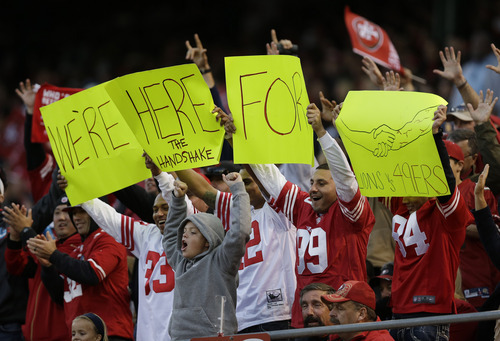 San Francisco 49ers fans cheer at halftime during an NFL football game against the Detroit Lions in San Francisco, Sunday, Sept. 16, 2012. (AP Photo/Marcio Jose Sanchez)