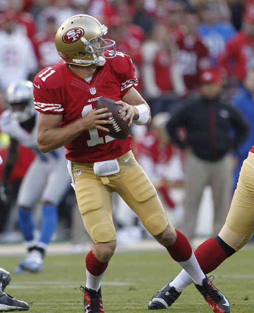 San Francisco 49ers quarterback Alex Smith drops back to throw during the second quarter of an NFL football game in San Francisco, Sunday, Sept. 16, 2012. (AP Photo/Tony Avelar)