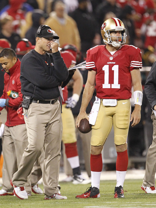 San Francisco 49ers head coach Jim Harbaugh, left, and quarterback  Alex Smith, right, during the fourth quarter of an NFL football game in San Francisco, Sunday, Sept. 16, 2012. (AP Photo/Tony Avelar)