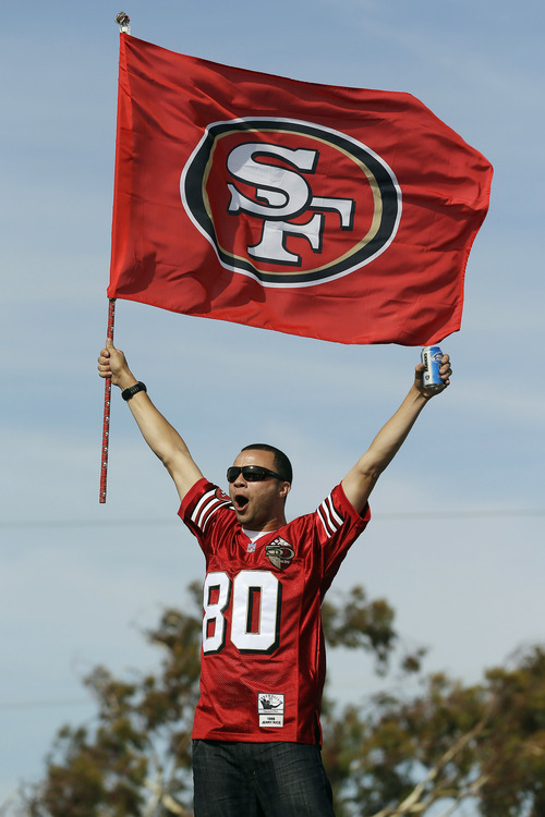 A San Francisco 49ers fan cheers outside of Candlestick Park before an NFL football game against the Detroit Lions in San Francisco, Sunday, Sept. 16, 2012. (AP Photo/Marcio Jose Sanchez)
