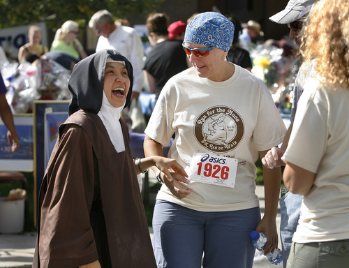 Scott Sommerdorf  |  The Salt Lake Tribune              Carmelite Sister Theresa speaks with Renata Strzelec, who had just finished the 3rd annual