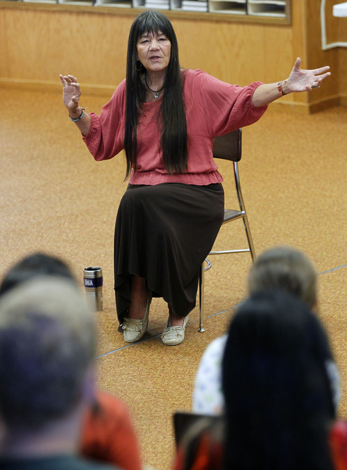 Al Hartmann  |  The Salt Lake Tribune Native American storyteller Dovie Thomason tells stories to Granger High students as part of a month-long Native American ancient art immersion project.