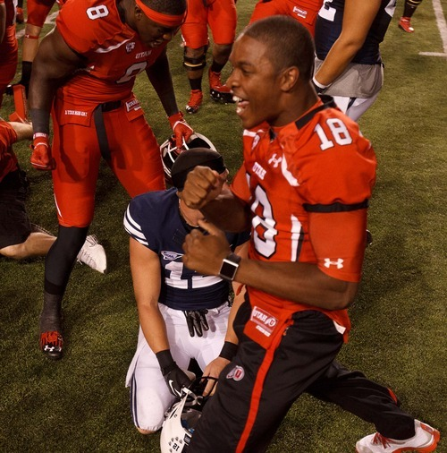 Trent Nelson  |  The Salt Lake Tribune Utah players celebrate the win over Brigham Young wide receiver JD Falslev (12) as Utah hosts BYU college football in Salt Lake City, Utah, Saturday, September 15, 2012.