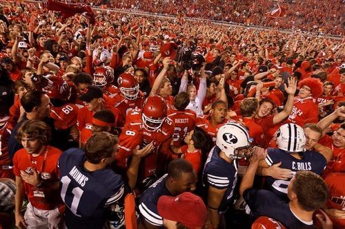 Trent Nelson  |  The Salt Lake Tribune Utah fans swarm the field as Utah defeats BYU college football in Salt Lake City, Utah, Saturday, September 15, 2012.