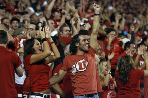 Chris Detrick  |  The Salt Lake Tribune Utah fans cheer during the second half of the game at Rice-Eccles Stadium Saturday September 15, 2012.  Utah won the game 24-21.