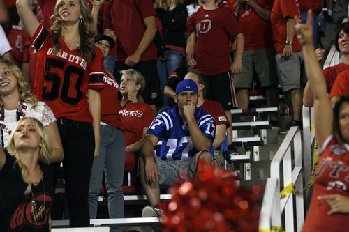 Chris Detrick  |  The Salt Lake Tribune Utah fans cheer as a BYU fan watches during the second half of the game at Rice-Eccles Stadium Saturday September 15, 2012.  Utah won the game 24-21.