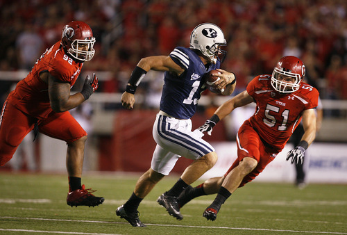 Scott Sommerdorf  |  The Salt Lake Tribune              BYU quarterback Riley Nelson is chased by Utah defensive tackle Star Lotulelei (92), left, and  linebacker Dave Fagergren (51) after flushing him out of the pocket during first-half play on Saturday, Sept. 15, 2012.