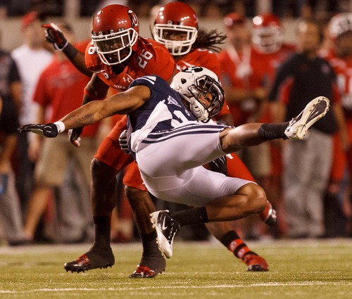 Trent Nelson  |  The Salt Lake Tribune Utah defensive back Ryan Lacy (26) pulls down Brigham Young wide receiver Cody Hoffman (2) as Utah hosted BYU in Salt Lake City on Saturday, Sept. 15, 2012.