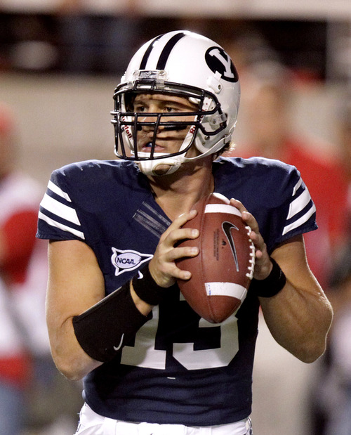 BYU quarterback Riley Nelson (13) looks for a receiver during the first quarter of an NCAA football game against Utah on Saturday, Sept. 15, 2012, in Salt Lake City. (AP Photo/Rick Bowmer)