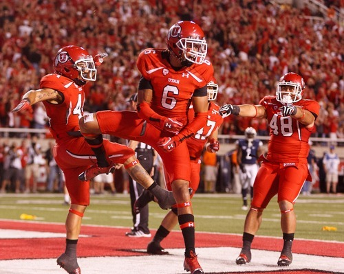 Trent Nelson  |  The Salt Lake Tribune Utah wide receiver Dres Anderson (6) celebrates his third-quarter touchdown against BYU in Salt Lake City on Saturday, Sept. 15, 2012.