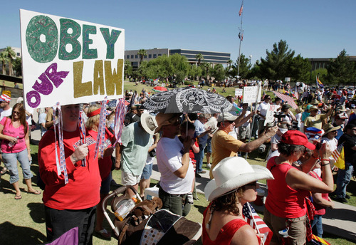 Associated Press file photo Hundreds gather in June 2010 at a rally supporting Arizona's law on illegal immigration near the Capitol in Phoenix. A judge ruled Tuesday, Sept. 18, 2012, that police in Arizona can immediately start enforcing the most contentious section of the state's immigration law by questioning the immigration status of those they suspect are in the country illegally.