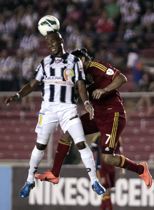 Panama's Tauro FC Leonel Parris, front, and U.S. Real Salt Lake Fabian Espindola go for a header during a CONCACAF Champions League soccer match in Panama City, Tuesday, Sept. 18, 2012. (AP Photo/Arnulfo Franco)