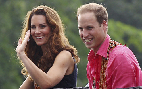 Rick Rycroft  |  The Associated Press Britain's Prince William and his wife Kate, the Duke and Duchess of Cambridge, smile as they watch a shark ceremony as they arrive at Marapa Island, Solomon Islands, Monday, Sept. 17, 2012.