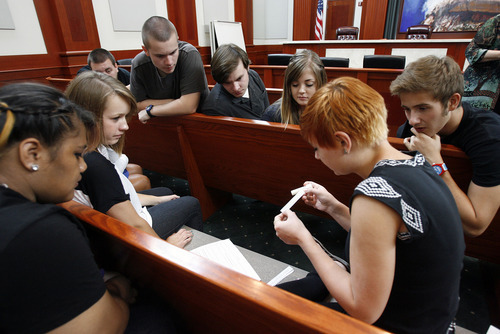 Francisco Kjolseth  |  The Salt Lake Tribune With the help of Justice Christine Durham, West High students learn some of the vocabulary of the law before being presented with a case in the Utah Supreme Court chambers. The group was participating in Constitution Day celebrations at the Matheson Courthouse on Monday, September 17, 2012, to honor the day 39 of the 55 founding fathers signed the Constitution of the United States marking the 225th anniversary.