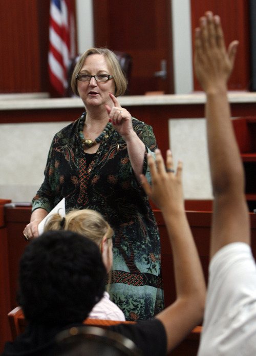 Francisco Kjolseth  |  The Salt Lake Tribune Justice Christine Durham looks to pick an eager Utah Supreme Court Judge from a group of West High students given the opportunity to learn more about the justice system. The group was participating in Constitution Day celebrations at the Matheson Courthouse on Monday, September 17, 2012, to honor the day 39 of the 55 founding fathers signed the Constitution of the United States marking the 225th anniversary.