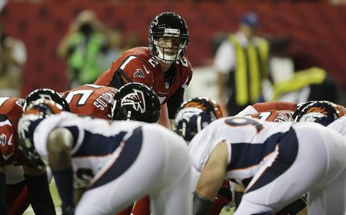 Atlanta Falcons quarterback Matt Ryan (2) prepares to take the snap against the Denver Broncos during the first half of an NFL football game, Monday, Sept. 17, 2012, in Atlanta. (AP Photo/David Goldman)