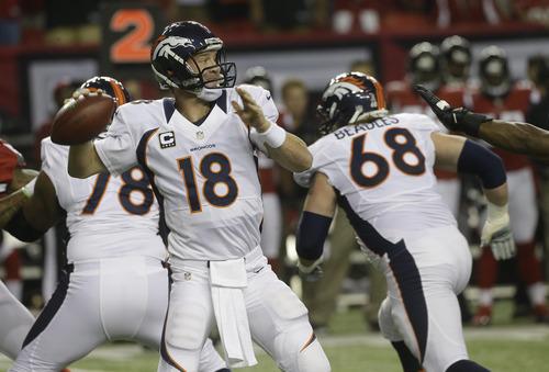 Denver Broncos quarterback Peyton Manning (18) works against the Atlanta Falcons during the first half of an NFL football game, Monday, Sept. 17, 2012, in Atlanta. (AP Photo/John Bazemore)