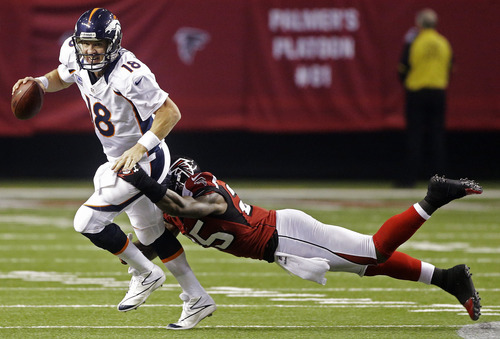 Denver Broncos quarterback Peyton Manning (18) is sacked by Atlanta Falcons strong safety William Moore (25) during the second half of an NFL football game, Monday, Sept. 17, 2012, in Atlanta. (AP Photo/John Bazemore)