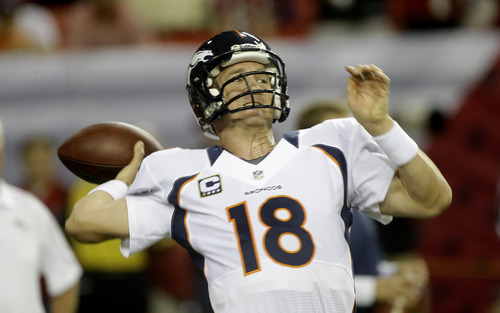 Denver Broncos quarterback Peyton Manning (18) works before the first half of an NFL football game against the Atlanta Falcons, Monday, Sept. 17, 2012, in Atlanta. (AP Photo/John Bazemore)