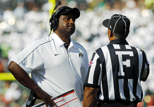 FILE - In this Saturday, Sept. 1, 2012, file photo, Colorado head coach Jon Embree, left, reacts to a call against his team after conferring with field judge Michael Mothershed as during the third quarter of an NCAA college football game against Colorado State in Denver. Embree is facing a chorus of jeers from fans after the Golden Buffaloes lost the opening three games of their 2012 season. (AP Photo/David Zalubowski, File)