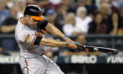 Baltimore Orioles' J.J. Hardy doubles in a run against the Seattle Mariners in the second inning of a baseball game, Monday, Sept. 17, 2012, in Seattle. (AP Photo/Elaine Thompson)