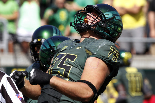 Oregon offensive lineman Jake Fisher reacts after recovering an Oregon fumble for a touchdown during the first half of their NCAA college football game against Tennessee Tech in Eugene, Ore., Saturday, Sept. 15, 2012. (AP Photo/Don Ryan)