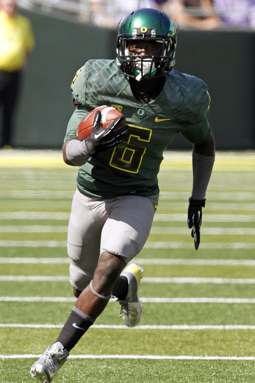 Oregon running back De'Anthony Thomas rushes during the first half of their NCAA college football game against Tennessee Tech in Eugene, Ore., Saturday, Sept. 15, 2012. Oregon won 63-14. (AP Photo/Don Ryan)
