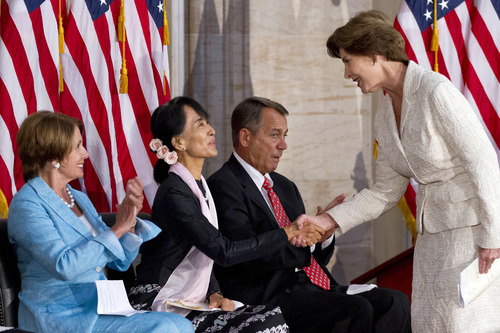 House Democratic Leader Nancy Pelosi, D-Calif., left, and Speaker of the House John Boehner, R-Ohio, sit next to Myanmar democracy leader Aung San Suu Kyi as she is greeted by former first lady Laura Bush, right, during a ceremony to award Suu Kyi with the Congressional Gold Medal at the U.S. Capitol in Washington, Wednesday, Sept. 19, 2012. (AP Photo/Jacquelyn Martin)