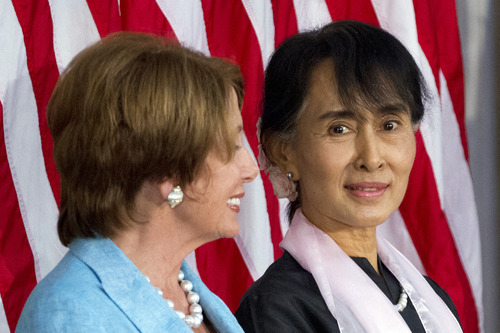 Myanmar democracy leader Aung San Suu Kyi, right, sits with House Democratic Leader Nancy Pelosi, D-Calif., during a ceremony to award Suu Kyi with the Congressional Gold Medal at the U.S. Capitol in Washington, on Wednesday, Sept. 19, 2012. (AP Photo/Jacquelyn Martin)