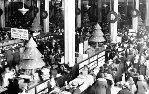FILE- In this Dec. 11, 1931 file photo, shoppers fill the ground floor at Macy's in New York. A $400 million makeover is giving New York's iconic Macy's store a sleek, new 21st century style.  (AP Photo/File)