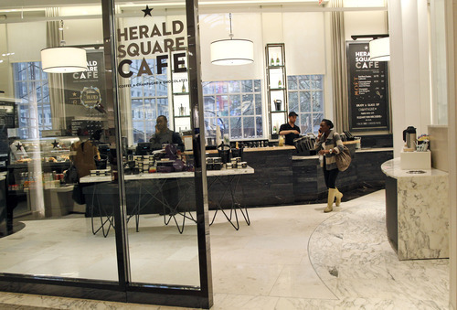 This Tuesday, Sept. 18, 2012 photo shows the newly-renovated Herald Square cafe at the Macy's flagship store in New York's Herald Square. A $400 million makeover is giving New York's iconic Macy's store a sleek, new 21st century style. (AP Photo/Mary Altaffer)