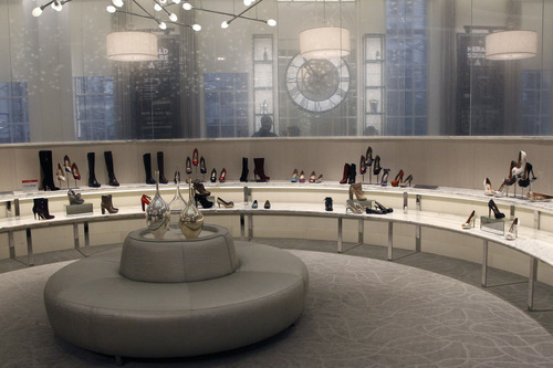 This Tuesday, Sept. 18, 2012 photo shows the newly-renovated shoe department at the Macy's flagship store in New York's Herald Square. A $400 million makeover is giving New York's iconic Macy's store a sleek, new 21st century style. (AP Photo/Mary Altaffer)