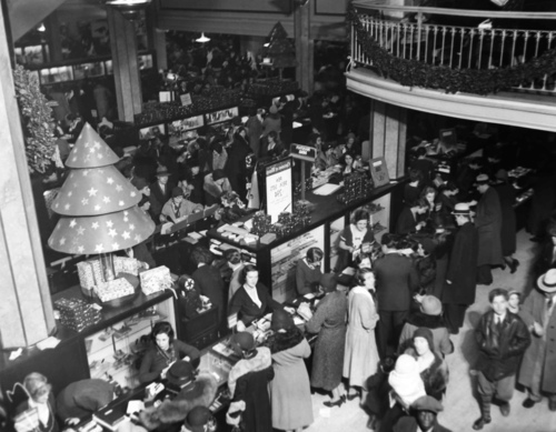FILE- In this Dec. 11, 1931, file photo, shoppers fill the ground floor at Macy's in New York.  A $400 million makeover is giving New York's iconic Macy's store a sleek, new 21st century style. (AP Photo/File)