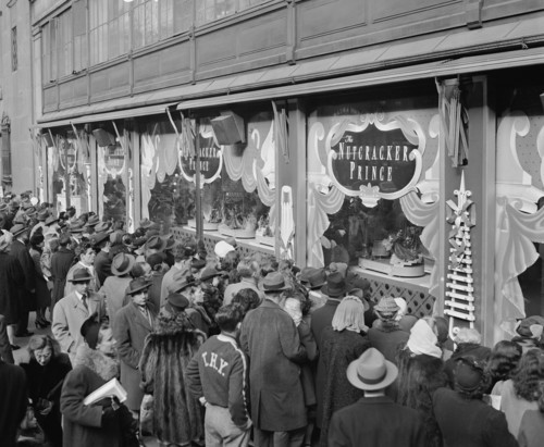 FILE- In this Dec, 24, 1946, file photo, last minute Christmas Eve shoppers gather in front of Macy's window display in New York.  A $400 million makeover is giving New York's iconic Macy's store a sleek, new 21st century style. ( AP Photo/Carl Nesensohn, File)