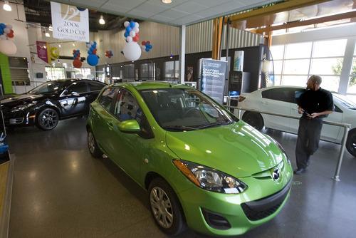 Paul Fraughton | The Salt Lake Tribune Brandon Thomas, a sales consultant at D.Dahle Mazada of Murray, in the dealership's  showroom. New car sales in Utah rose substantially in 2011.