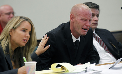 Al Hartmann  |  The Salt Lake Tribune Eric Charlton sobs during his preliminary hearing in Judge James Brady's Fourth District Court in Nephi Wednesday September 19.  He is comforted by his defense lawyer Susanne Gustin.    He is charged with one count of manslaughter, a second-degree felony; reckless endangerment, a class A misdemeanor; and carrying a dangerous weapon under the influence of alcohol/drugs, a class B misdemeanor, for the accidental shooting death of his 17-year-old brother, Cameron Bryce Charlton, May 28.