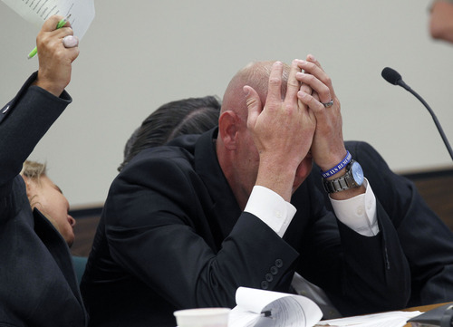 Al Hartmann  |  The Salt Lake Tribune Eric Charlton, holds his head and sobs during his preliminary hearing in Judge James Brady's Fourth District Court in Nephi Wednesday September 19.     He is charged with one count of manslaughter, a second-degree felony; reckless endangerment, a class A misdemeanor; and carrying a dangerous weapon under the influence of alcohol/drugs, a class B misdemeanor, for the accidental shooting death of his 17-year-old brother, Cameron Bryce Charlton, May 28.