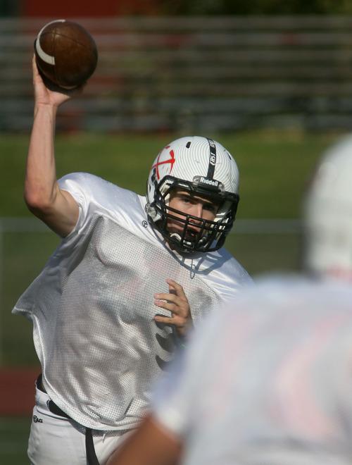 Steve Griffin   The Salt Lake Tribune Park City High School quarterback, Ian Moritz, fires a pass during practice at the school.